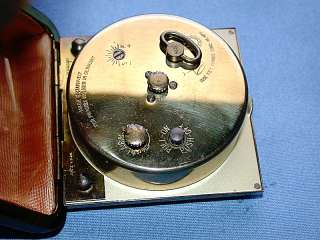 an Antique German Phinney Walker Windup Leather Travel Alarm Clock